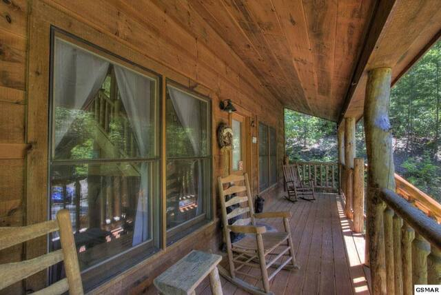 Honeymoon Cabin porch with rocking chairs