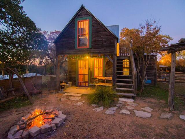 Secluded cabin exterior with fire pit near Fredericksburg Texas