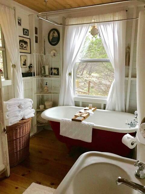 romantic claw bathtub in hill country cabin