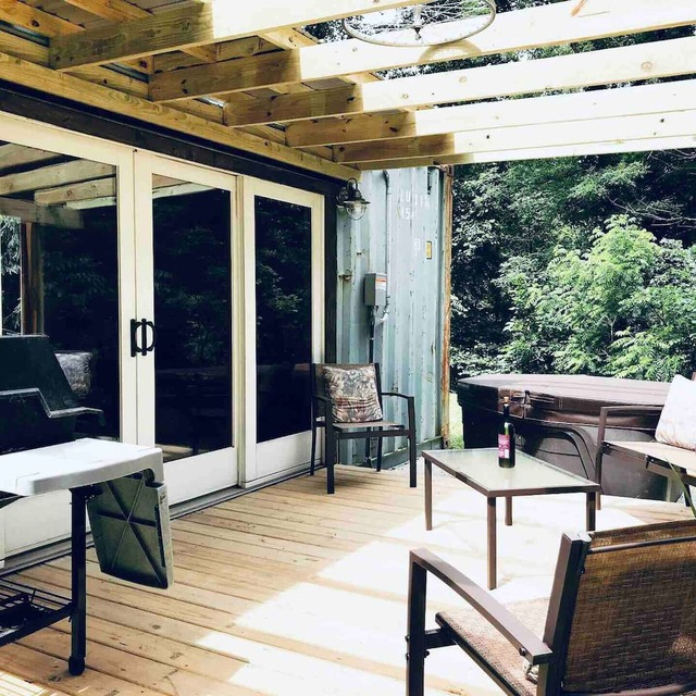 Container Tiny Home porch with Hot Tub, grill and seating