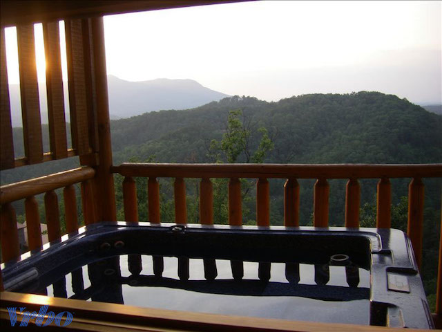 view from cabin with hot tub outside