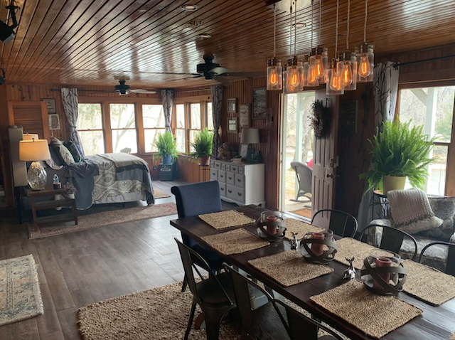 studio style cabin dinning room followed by bedroom area