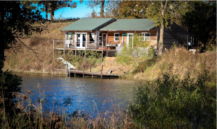cabin siturated on a lake with dock