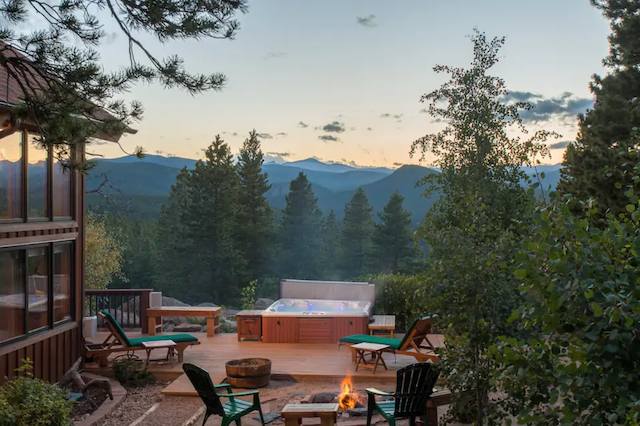 Hot tub on cabin deck with view