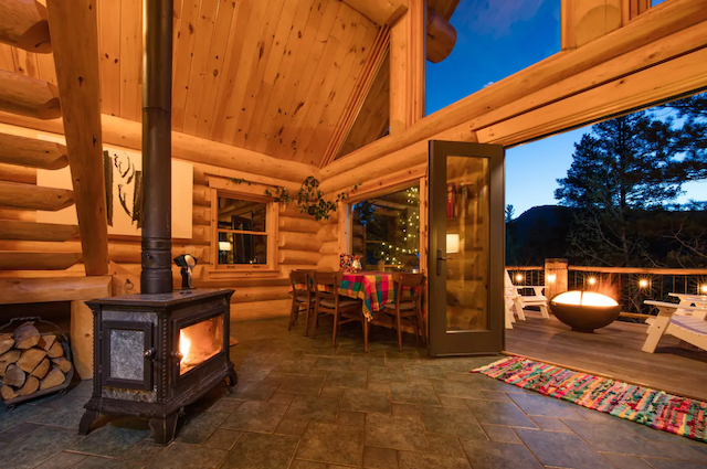 Cabin with fire pit fire on porch with doors open
