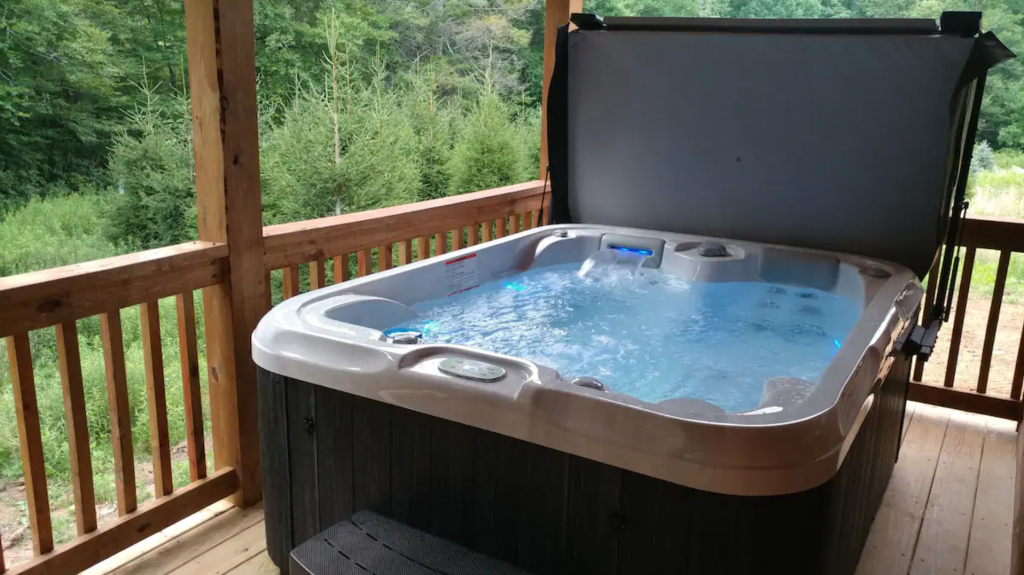 hot tub at Country Bumpkin Cabin 30 Minutes From Boone