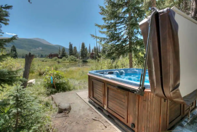View of mountains with hot tub in foreground