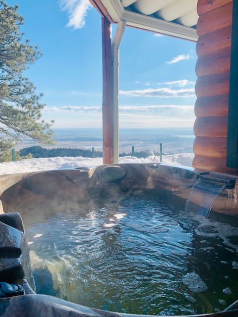 Steamy hot tub surrounded by snow