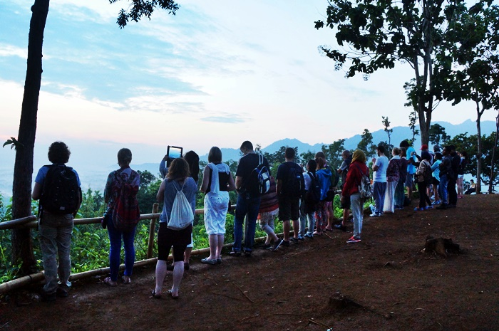 Many people standing and waiting the sunrise at Punthuk Setumbu