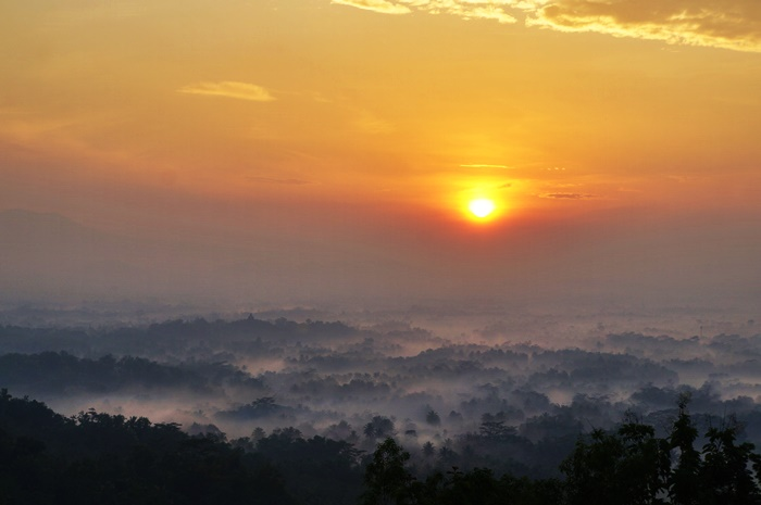 The sun rise slowly from the east and showered Borobudur temple with ray of light.