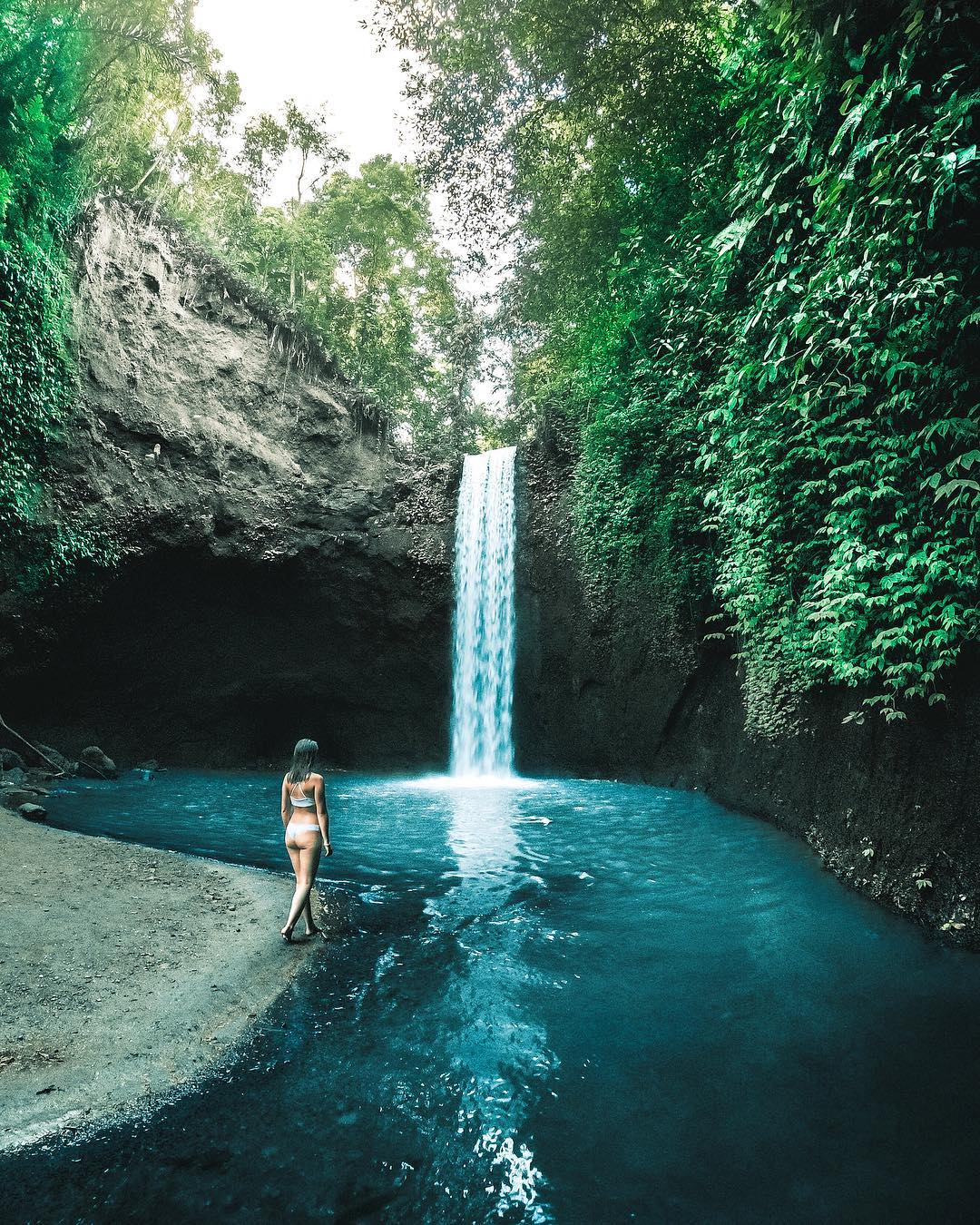 Tibumana Waterfall Bali is a twin waterfall with 2 adjoining streams. But when the river water above it is small, there is only one large stream that drops into a waterfall. via  @jackobhere