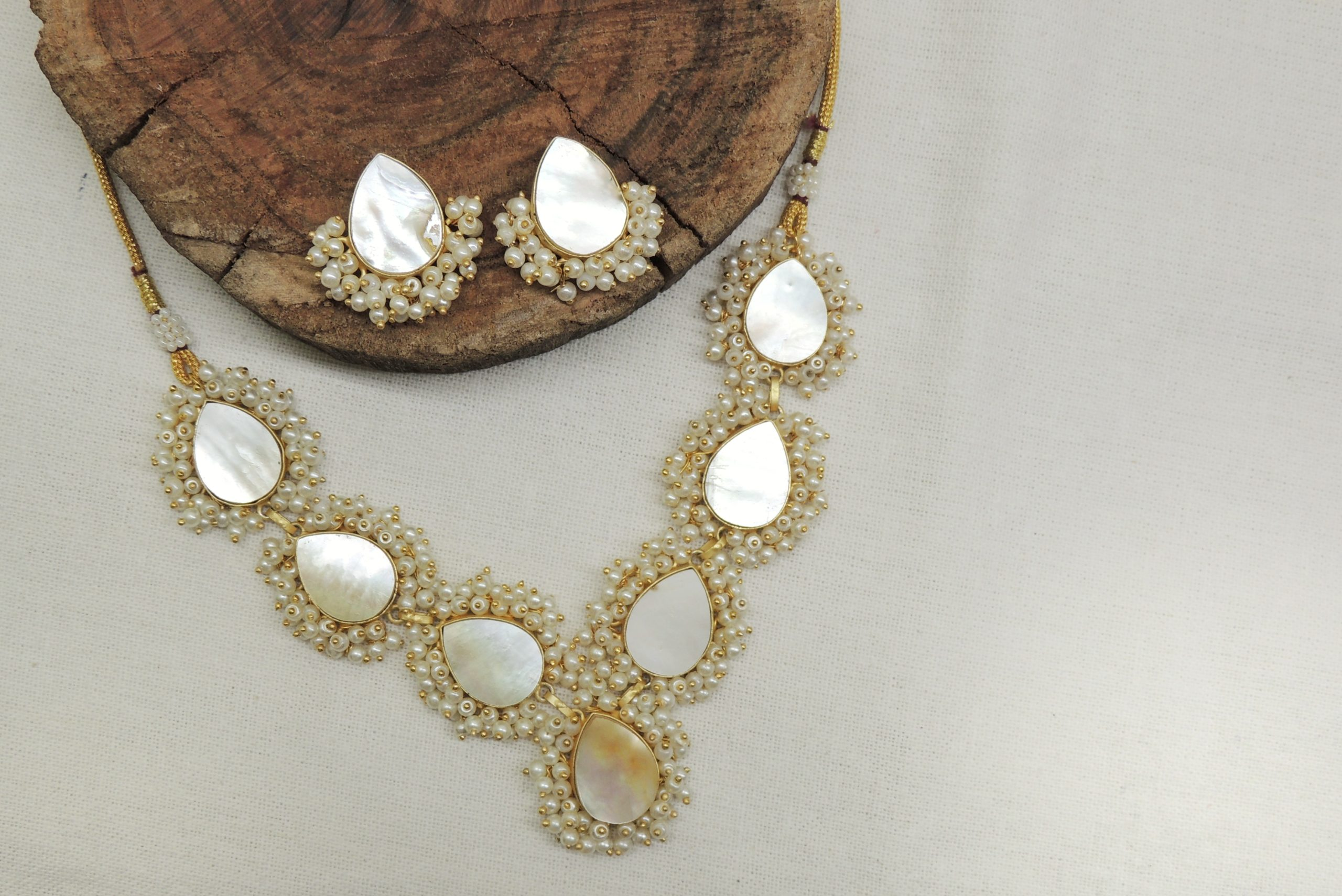 Stylish MOP Paan Shape Gold Plated Necklace With Studs