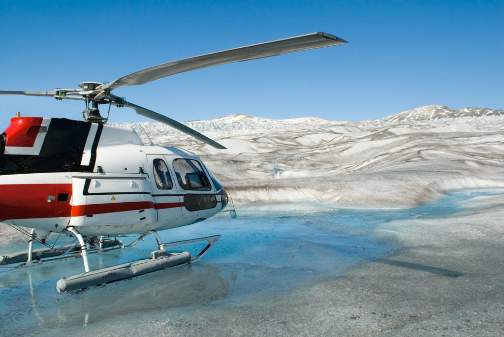 Helicopter landed on the smooth blue icy surface of a glacier in Alaska.Click on any of the sample images below to view a lightbox of all of my snow and glaciers shots: