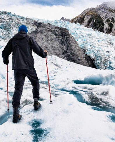 Glacier hiker on Franz Josef Glacier in Westland Tai Poutini National Park part of the Southern Alps, New Zealand.