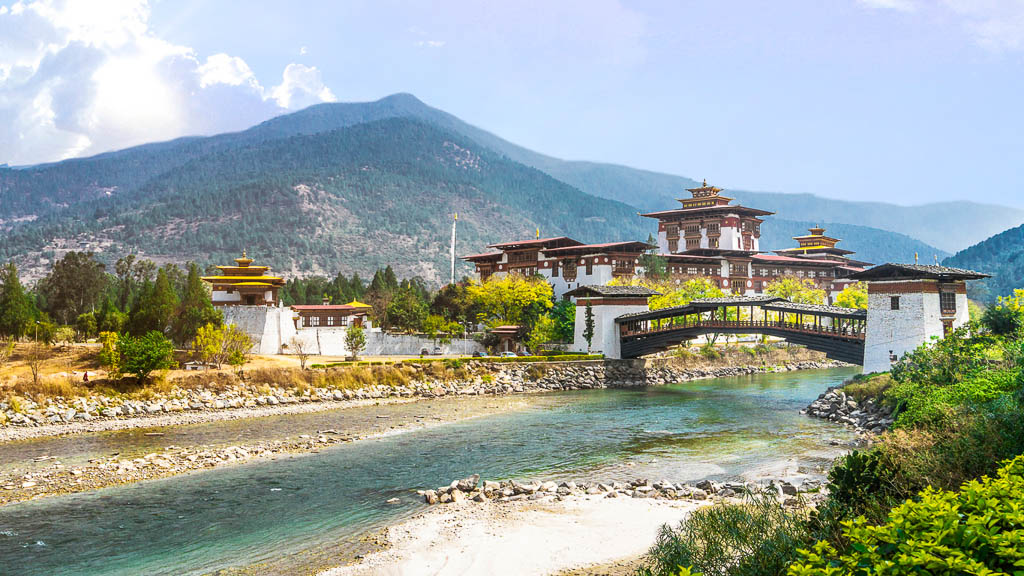 The Punakha Dzong Monastery and bridge across the river in Bhutan Asia one of the largest monestary in Asia with the landscape and mountains background, Punakha,Bhutan