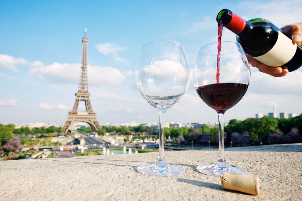 Two glasses and a fresh bottle of red wine overlooking the Eiffel Tower Paris