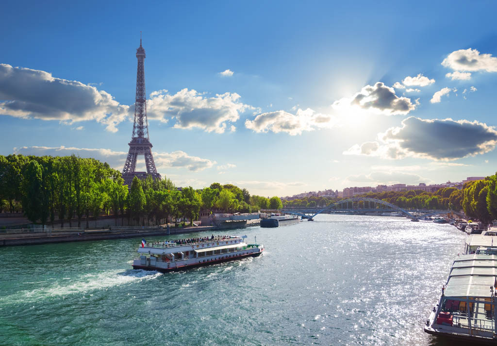 Eiffel Tower and bridge Iena on the river Seine in Paris, France.