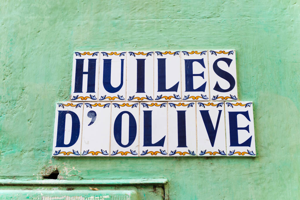 Olive oil sign, ceramic tiles on green wall, in Provence, France, Europe.