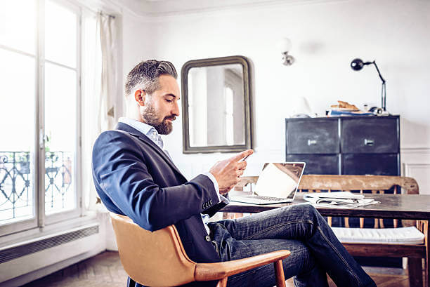 man looking at growth strategy on phone
