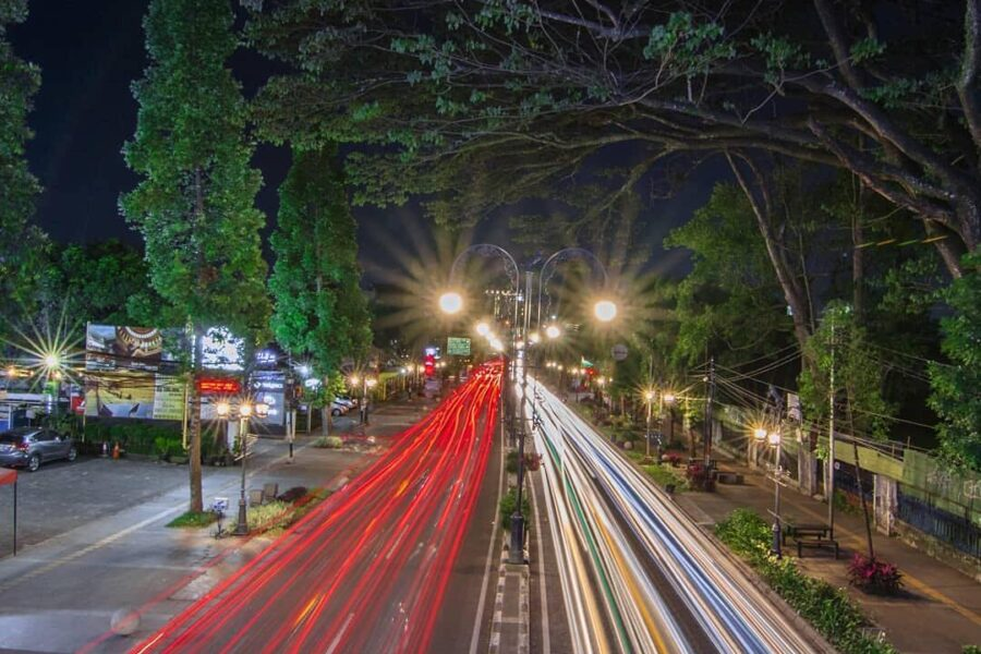 Blazing lights from fast-pacing vehicles on the street of Dago. Make sure to alw...