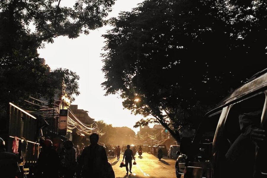 The sun is rising as people of Andir walk by, ready to start their day. - #eb_pe...