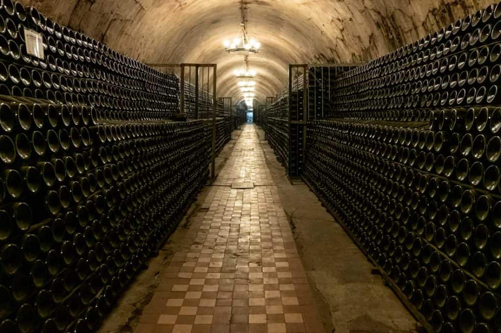 Best Wine Tours In The USA Antique cellar with aged wine bottles