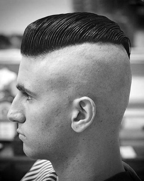 The disconnected undercut hairstyle is characterized by a sharp contrast between the very short or shaved sides and longer hair on top. 40 Slicked Back Undercut Haircuts For Men Manly Hairstyles