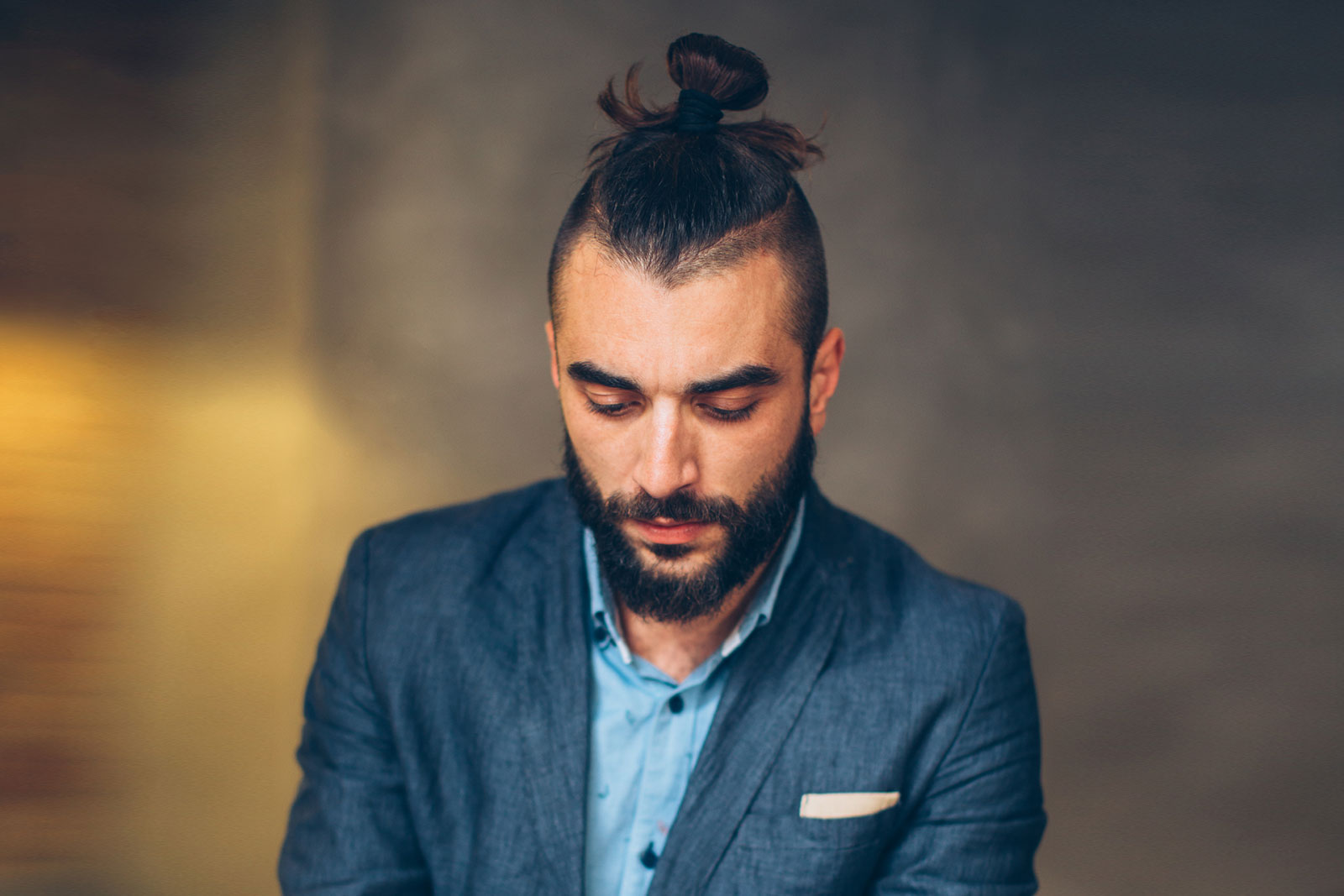 2.7 spiky blonde hair with low fade; The Man Bun Guide 58 Ways To Wear It
