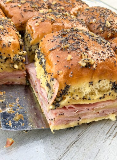 Homemade ham and cheese sliders with a buttery poppy seed sauce