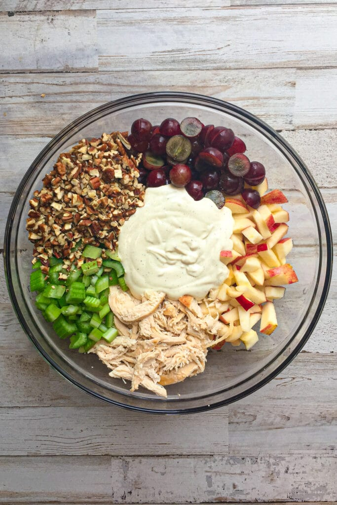 chicken salad ingredients in a mixing bowl