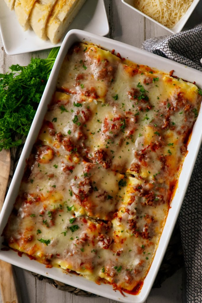 a casserole made with lasagna rolls with parmesan and mozzarella cheese