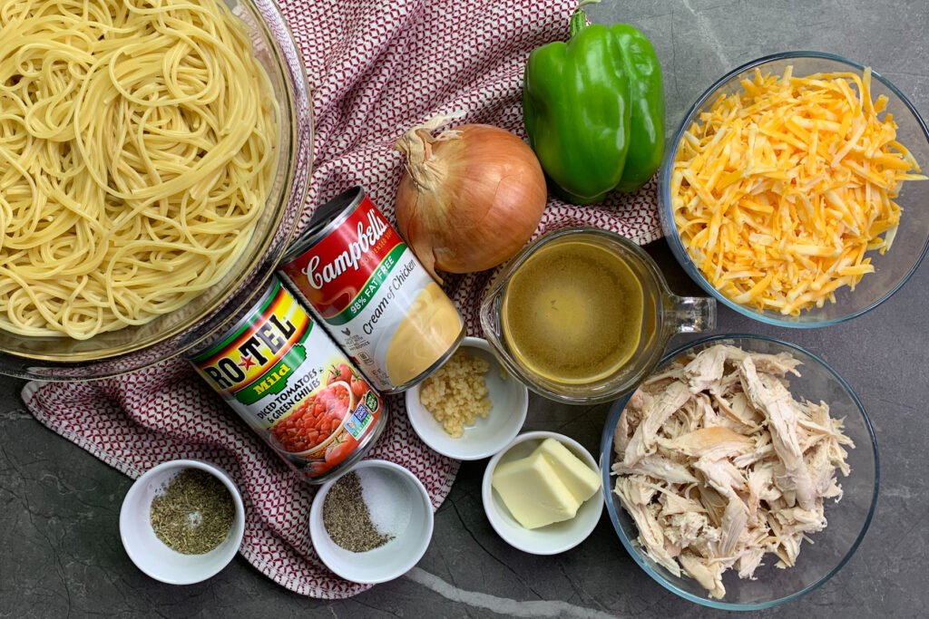 All the ingredients to make cheesy chicken spaghetti.