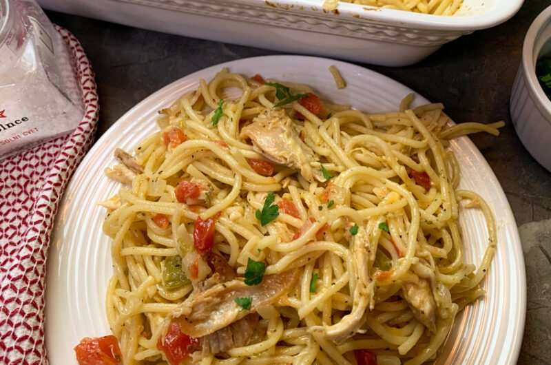 Close up of chicken spaghetti on a white plate ready to be eaten.