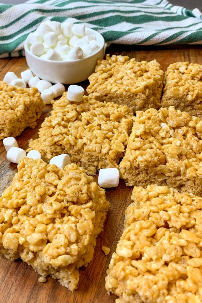 Close up of peanut butter rice Krispie treats cut into squares.