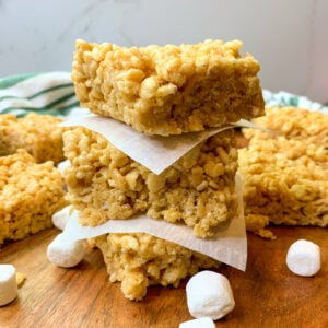Peanut butter rice Krispie treats stacked on top of each other.