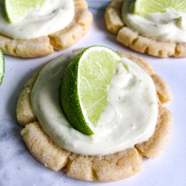 Key lime cookies garnished with a lime wedge