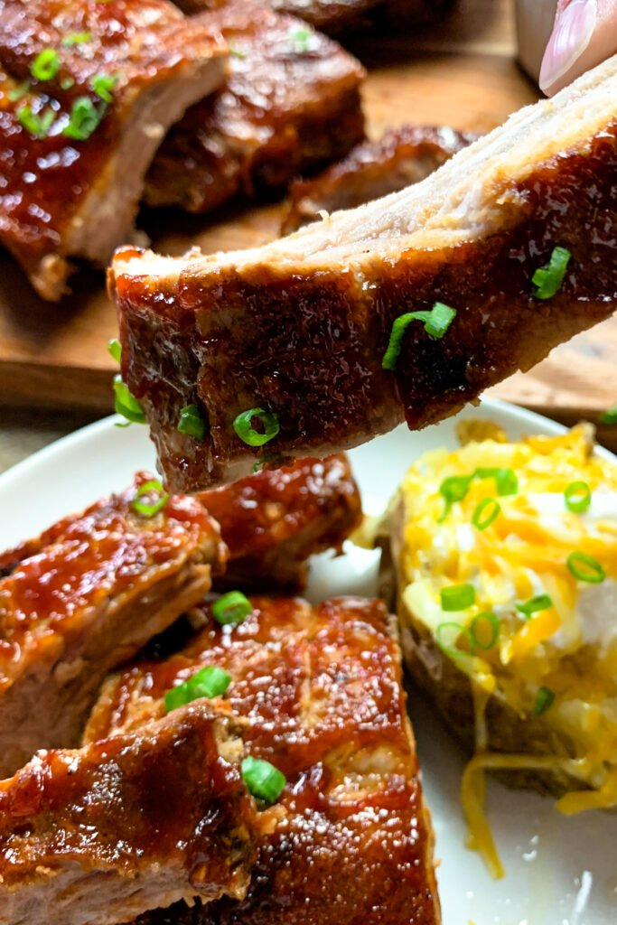 Close up of barbecue ribs in the love to show the texture of the pork.