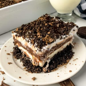 Close up of chocolate lasagna on a white plate.