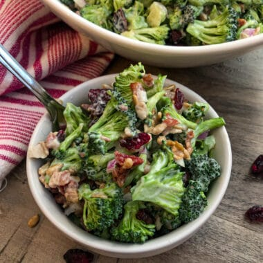 Broccoli salad recipe in a serving bowl with a fork for eating