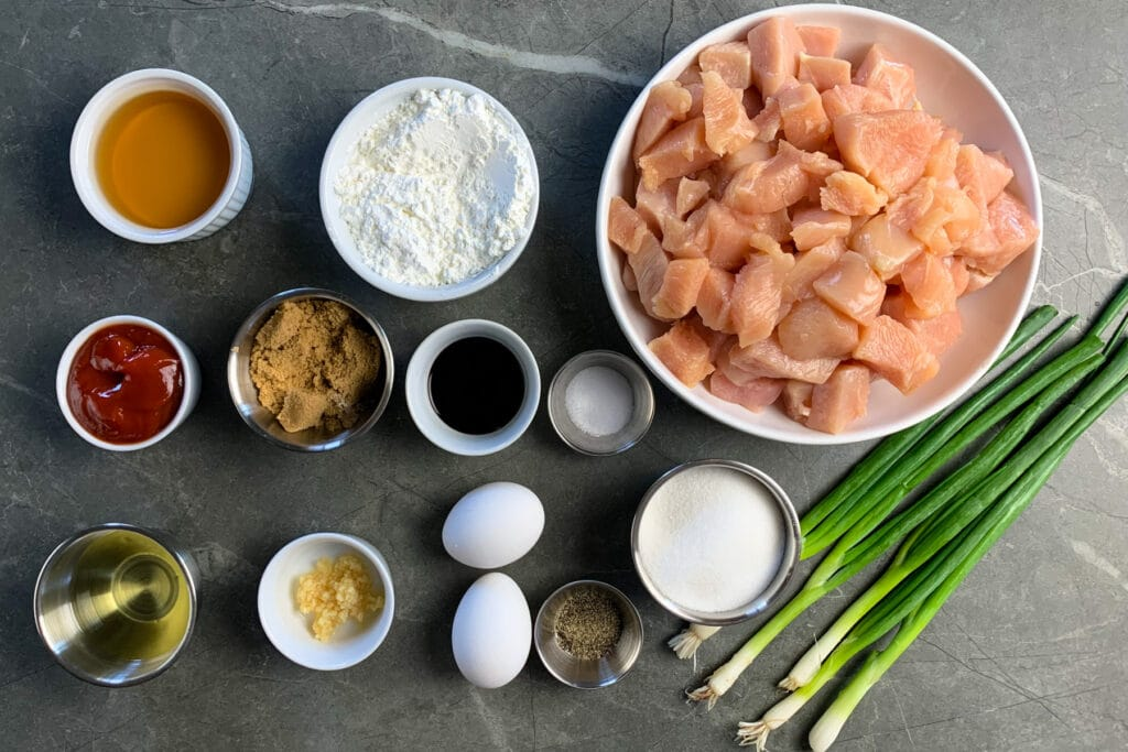 All the ingredients needed to make sweet and sour chicken.