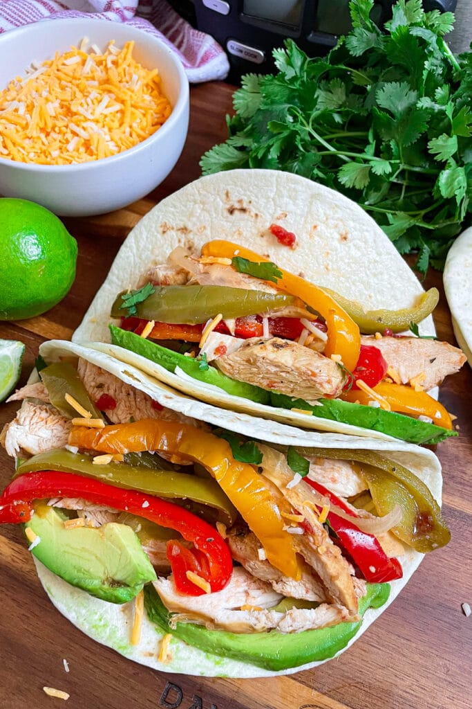 slow cooker chicken fajitas with shredded cheese and cilantro