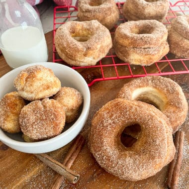 air fryer donuts with cinnamon and sugar and a glass of milk on the side