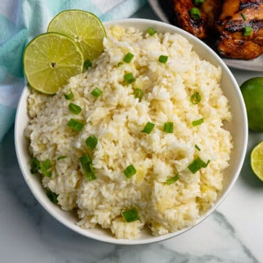Hawaiian rice with crushed pineapple and garnished with green onion.
