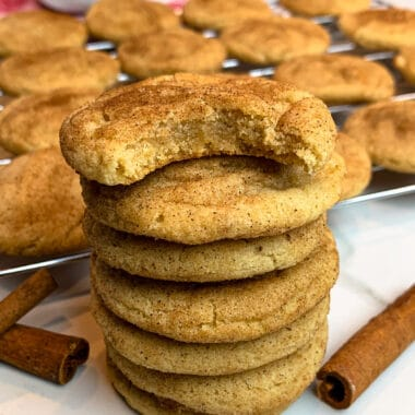 Soft Snickerdoodle cookies stacked on top of each other.