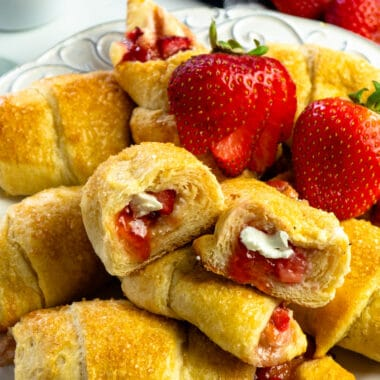 Close up of strawberry cheesecake crescent rolls cut in half to show off the filling.