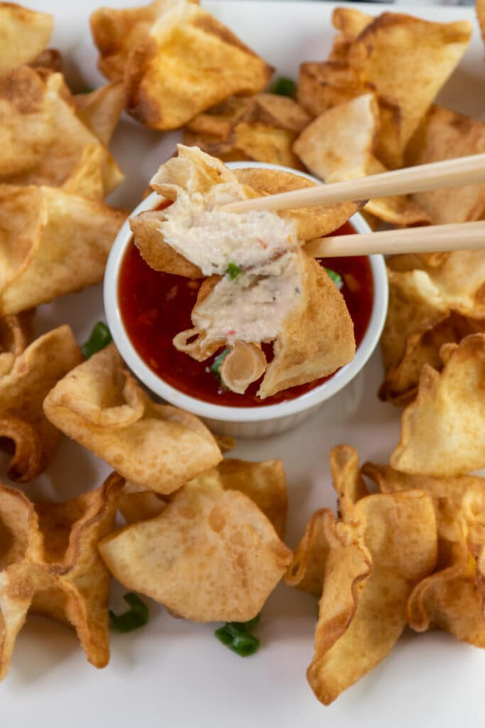 Close up of a crab Rangoon to show off the cream cheese filling.
