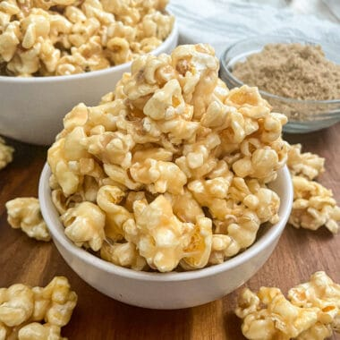 The most amazing caramel popcorn served in a white bowl