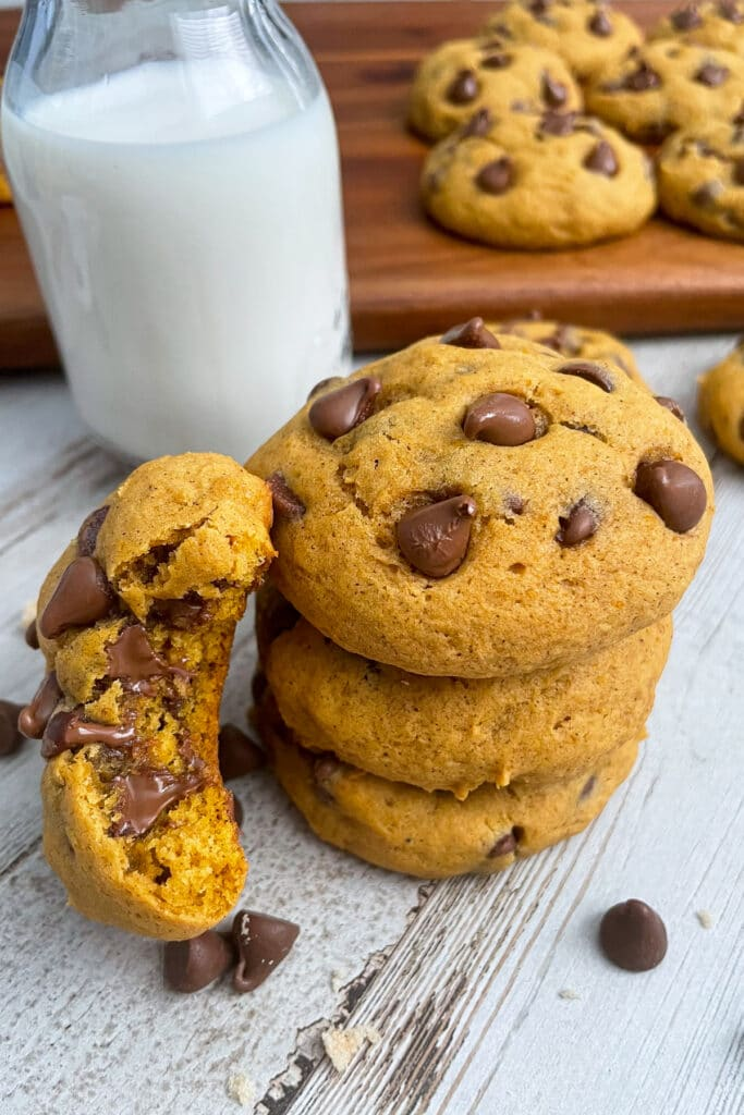 pumpkin chocolate chip cookies served with a glass of milk on the side