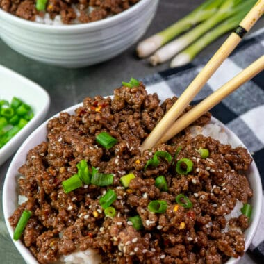 Close Up of Korean ground beef bowl garnished with sesame seeds and green onions.