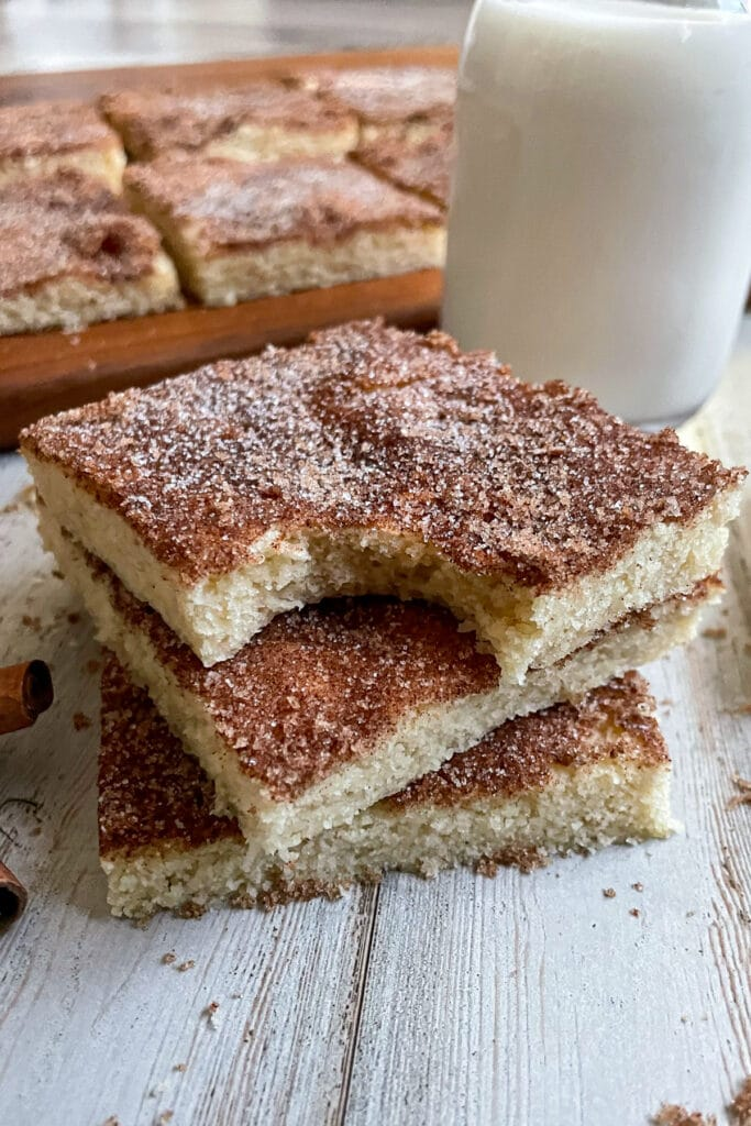 Snickerdoodle cookie bars served with a glass of milk